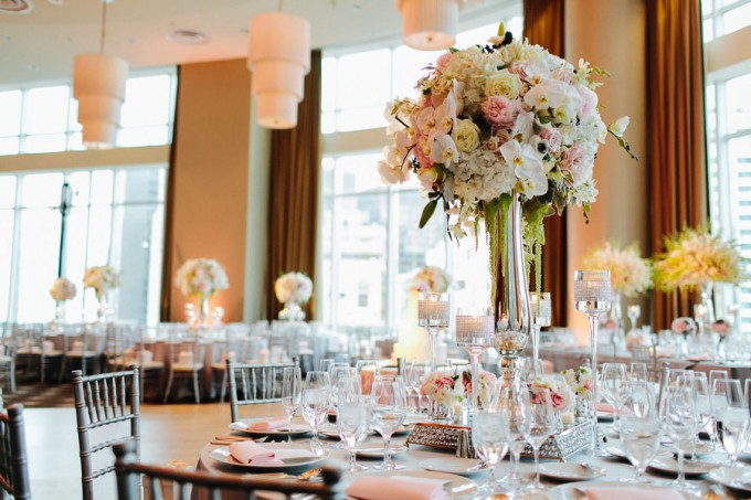 65. Trump. Pen Carlson Photography. Sweetchic Events.Vale of Enna. Mirrored Vase Centerpiece Hydrangea, Lillies, Orchids, Blush Pink Peonies, Roses, Hanging Amaranthus.
