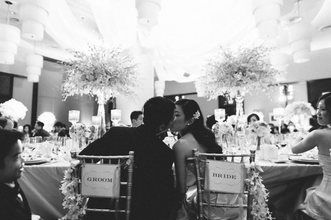 82. Trump Tower Wedding. Pen Carlson Photography. Sweetchic Events.  Bride and Groom Kiss. Bride and Groom Chair Signs.