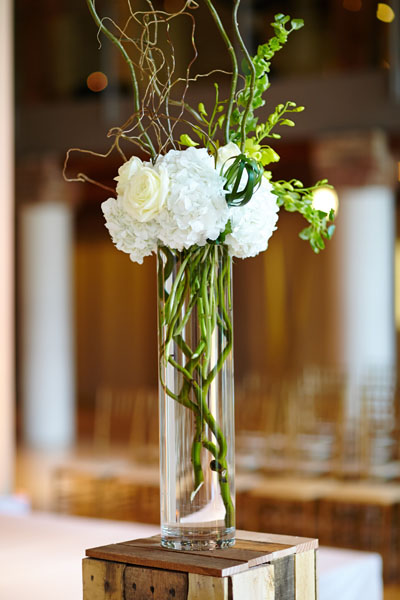 30. River East Art Center Wedding. Dennis Lee Photography. Sweetchic Events. Revel Decor. Ceremony Aisle Decor. Tall Hydrangea and Curly Willow.