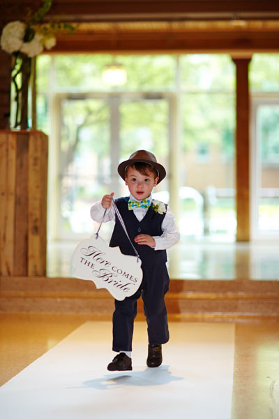 32. River East Art Center Wedding. Dennis Lee Photography. Sweetchic Events. Ringbearer with Here Comes The Bride Sign.