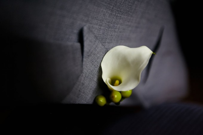 7. River East Art Center Wedding. Dennis Lee Photography. Sweetchic Events. Revel Decor. Groom's miniture cala lilly boutonierre.