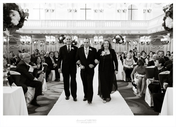 23. Blackstone Hotel Wedding. Deonna Caruso Photography. Sweetchic Events. Groom and Parents Walk Down Aisle