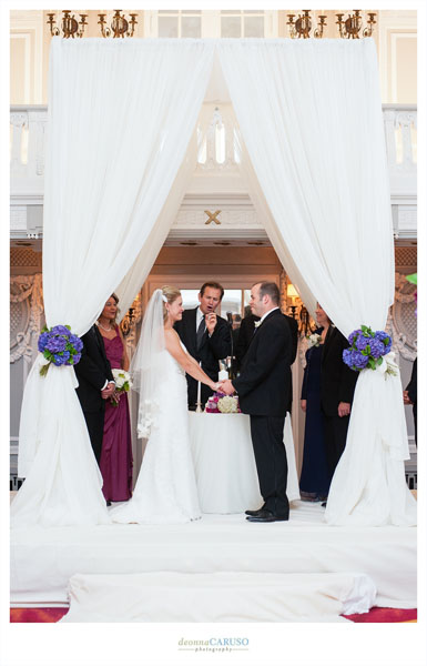 25. Blackstone Hotel Wedding. Deonna Caruso Photography. Sweetchic Events. Flor Del Monte. Ivory Fabric Chuppah with Purple Hydrangea En Masse.