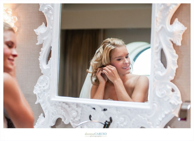 3. Blackstone Hotel Wedding. Deonna Caruso Photography. Sweetchic Events. Bride getting ready in front of mirror.