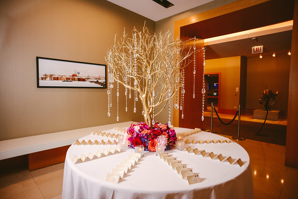 11.  Intercontinental Ohare Wedding. Fragola Productions. Sweetchic Events. Vale of Enna. Dramatic Manzanita branch escort card arrangement. Hanging crystals.