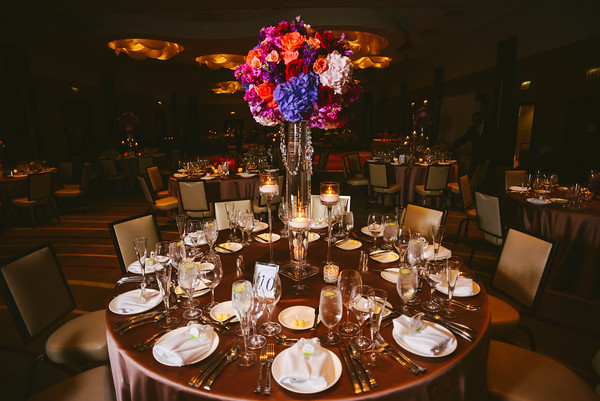 22.  Intercontinental Ohare Wedding. Fragola Productions. Sweetchic Events. Large Lush romantic florals atop bullet vase. Roses Hydrangeas stock orchids. pink.