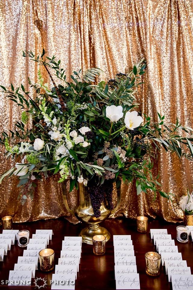 18. Art Deco Wedding. Kitchen Chicago. Victoria Sprung Photography. Sweetchic Events. Asrai Garden. Sequin Backdrop. Escort Cards. Gold Urn Florals