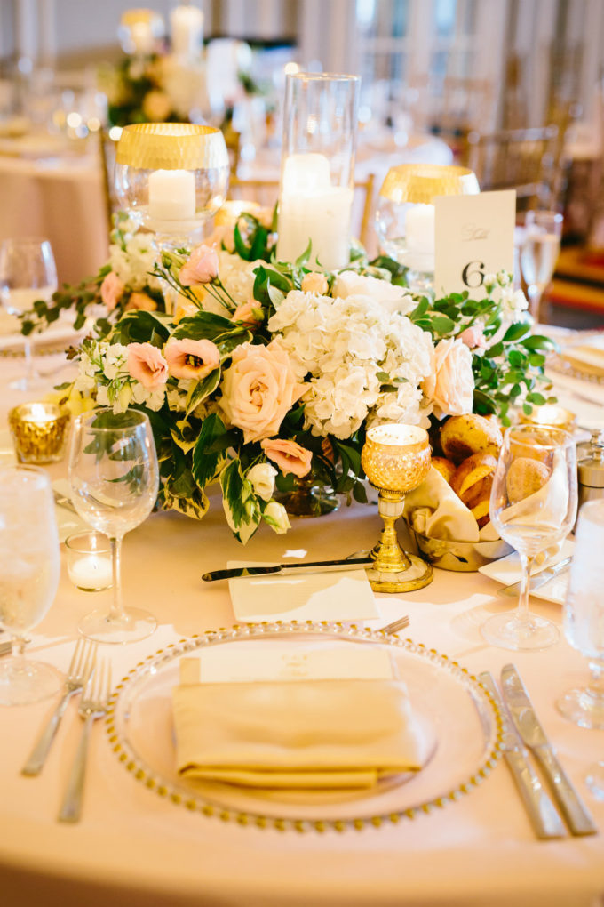 28-blackstone-chicago-wedding-pen-carlson-sweetchic-events-vale-of-enna-centerpiece-low-and-lush-gold-blush-peony-candles-roses-hydrangea