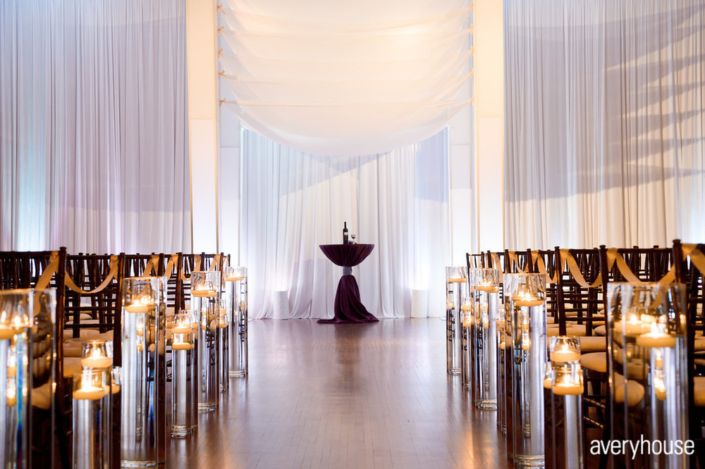 21.  The Ivy Room. Avery House. Sweetchic Events. Flower Firm. Custom Seven Layer White Chuppah. Tall Glass Vase with Candle Aisle Decor.