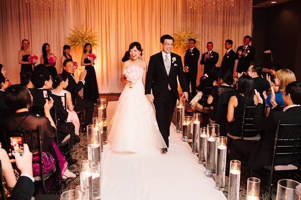51. Suisui.David.Waldorf Astoria. Pen Carlson Photography. Sweetchic Events. Bride and Groom walk down candle lit aisle