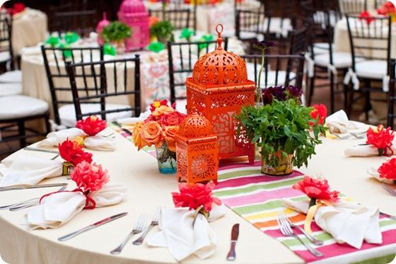 Fiesta rehearsal dinner tablescape lanterns tulips orange pink