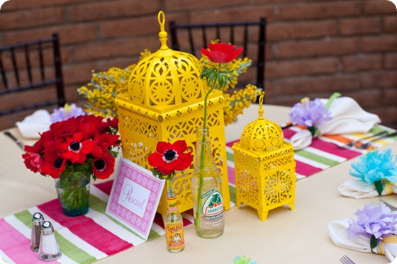 Fiesta rehearsal dinner tablescape yellow lanterns red anemones