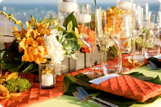 Orange green tablescape orchids succulents