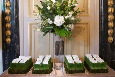 escort card bed of wheat grass floral arrangement sweetchic events
