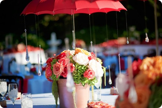 whimsical umbrella centerpiece roses hydrangea pink red green