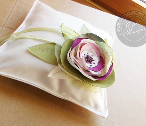white ring bearer pillow with purple green floral accents