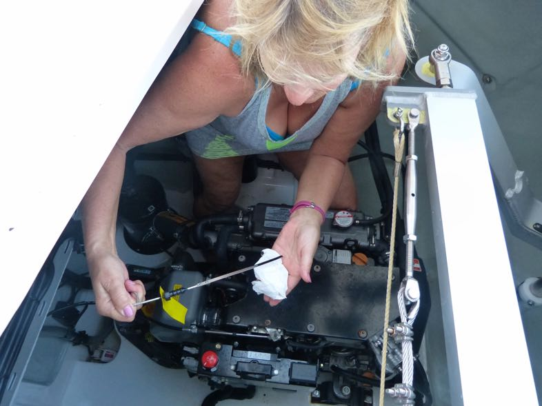 Betsy checking the oil