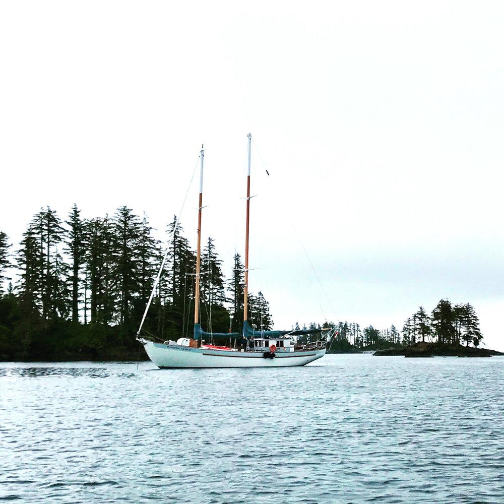 Passing Cloud at anchor
