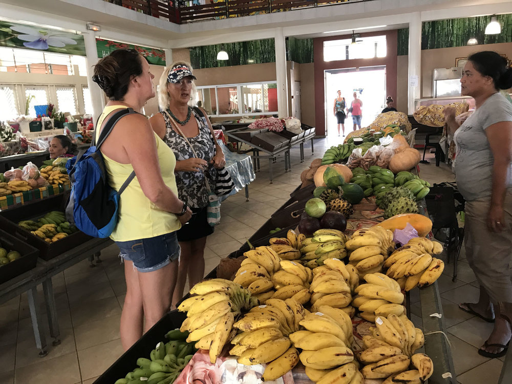 Betsy and Jane provisioning at the fresh food market in Raiatea