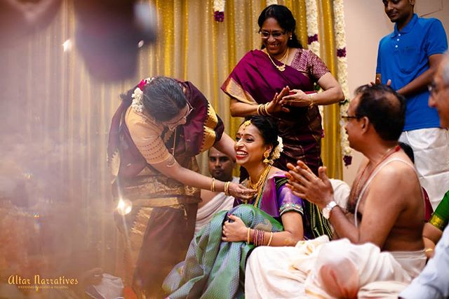 "In the Tamil culture during engagements they say ""Pon koduthu Pon edukurom"" which roughly translates to Giving gold and taking back the daughter.  In the picture Mother of the Groom adorns her future daughter-in-law with gold as they all share a light moment. . . . . . . . . . . . #engagement #justhitched #tamilbride #bridetobe #chennaiphotographer #candidmoment #bridalglow #junebugweddings #chennaiweddingphotography #shopzters #wedmegoodsouth #instawedding #instabride #laughoutloud #goodvibesonly #dday #bridalwear #bridetrends #indianbride"