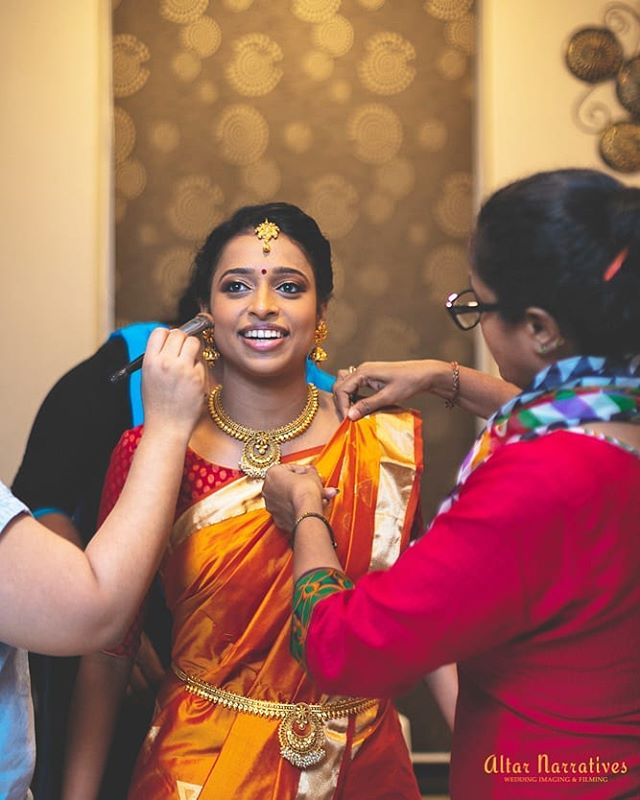 Bhavana having an authentically unposed, filmy moment during her getting ready while @anithasridharmakeup and her amazing team are working their magic. . . . . . . . . . . #bride #bridestory #bridemakeup #hitched #prettybride #bridalmua #engagement #candidweddingphotography #candidphotography #theknot #indianwedding #popxowedding #bridesofinstagram #weddingbells #brideinspiration #instawedding #instabride #candid