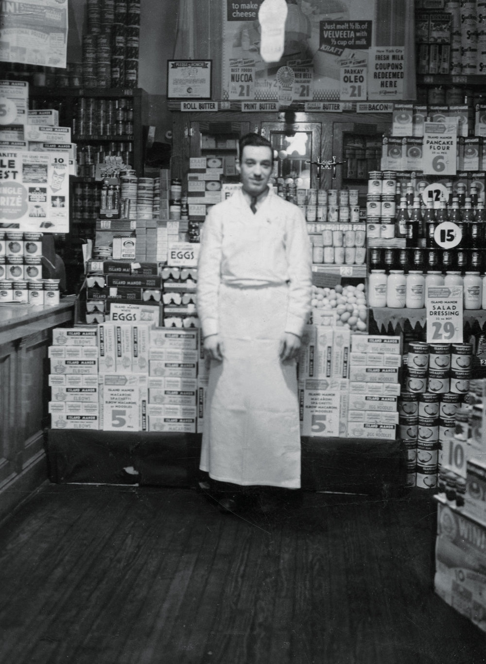 August Dalpiaz working in a Brooklyn, New York grocery store during the Depression. Note the prices.