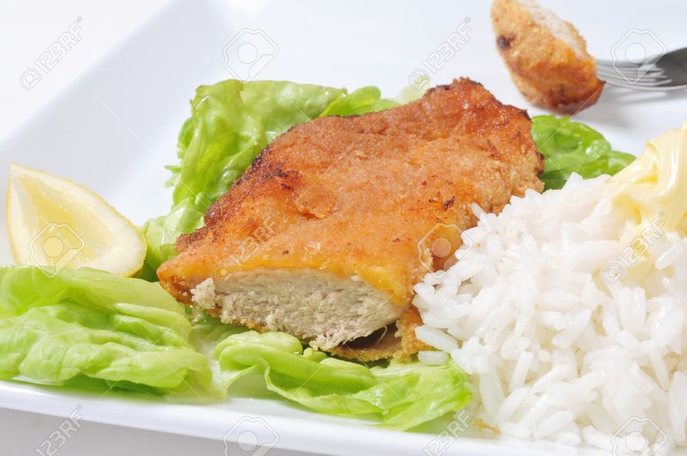 10658039-chicken-schnitzel-with-rice-lettuce-and-lemon-.jpg