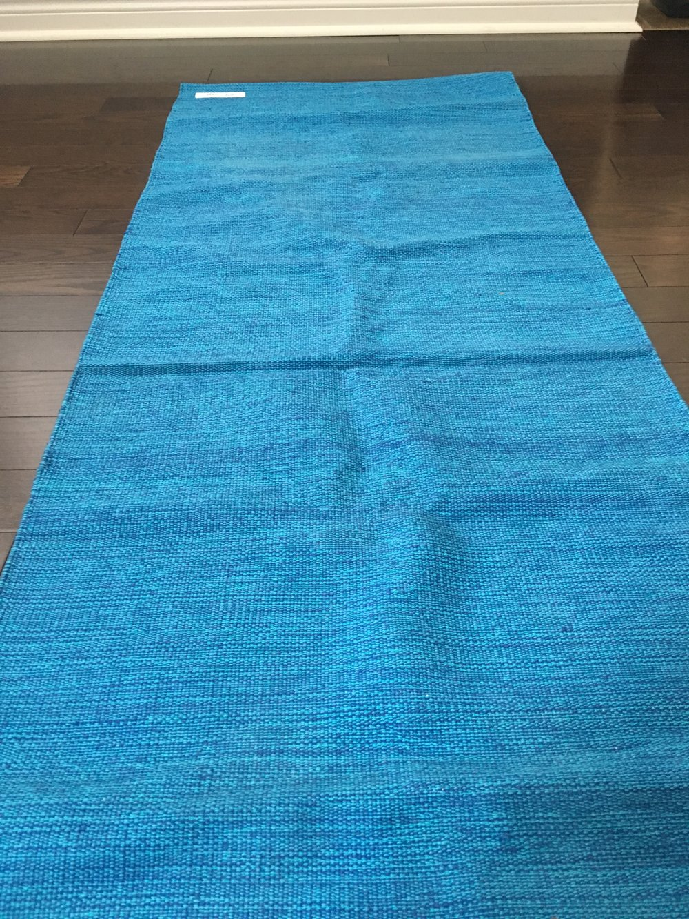 Here's my Ekaminhale Yoga Rug in blue.  Its stiff and firm but I love it.  You can get your own from Ekaminhale or if you are in Canada, you can get them from Amazon.