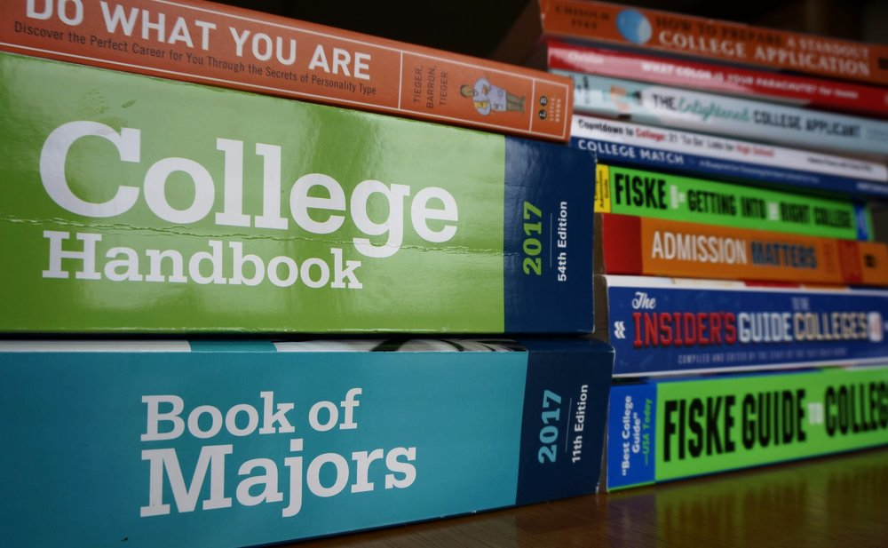 Stack of COllege SEARCH and admissions GUIDEBOOKS. Links to Blog Page.