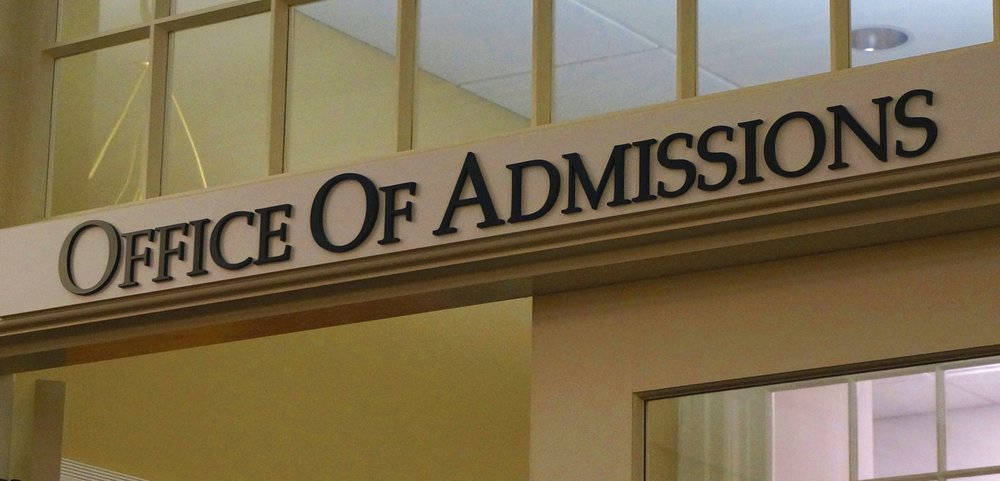 Office of Admissions sign above door on college campus. Links to Blog page on this site.