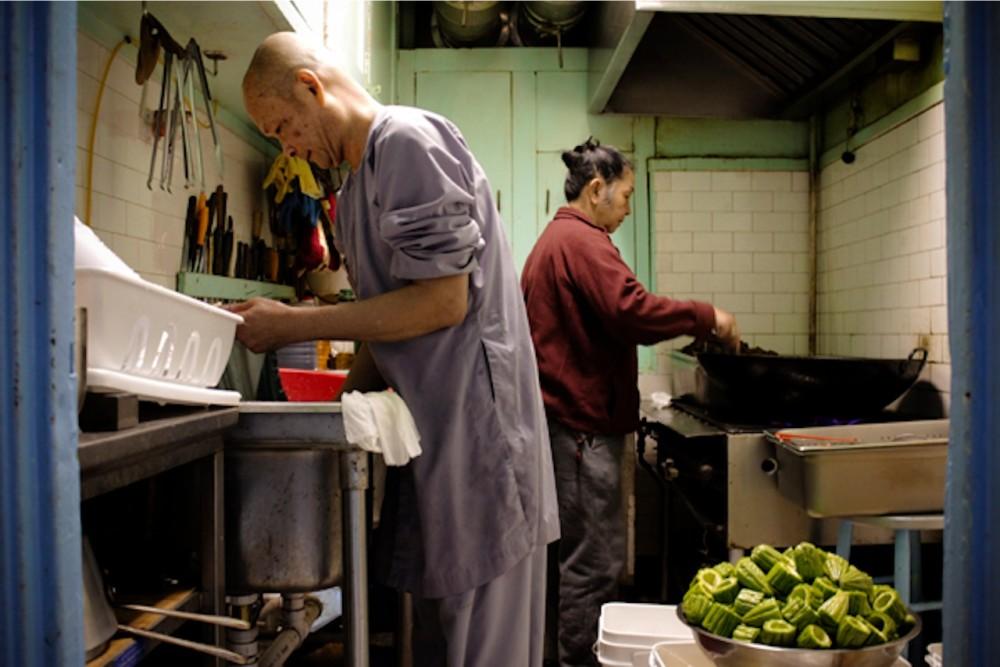 Thich Thien Chi at work int he kitchen
