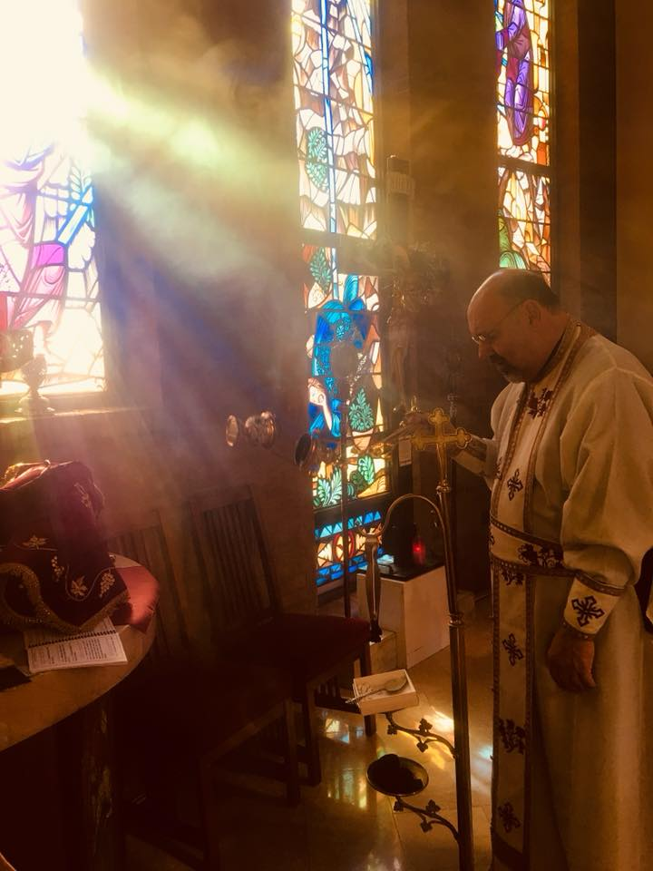 """Fr. Nick blesses the Proskomedia during the Orthros service this morning, the first Liturgical service of 2018 - the Feast of Saint Basil the Great. The Proskomedia (from the Greek προσκομιδή, """"offering""""), sometimes referred to as prothesis (from the Greek πρόϑεσις, """"setting forth"""") or proskomide, is the Office of Oblation celebrated by the priest prior to the Divine Liturgy during which the bread and wine are prepared for the Eucharist. The Proskomedia is a prerequisite for the Divine Liturgy. The priest conducts the Office of Oblation behind the Iconostasis at the Table of oblation or Table of Preparation (also Prothesis, or sometimes Proskomide) that is located to the left of the Altar Table. Proskomedia, when translated to English, means """"preparation."""""""