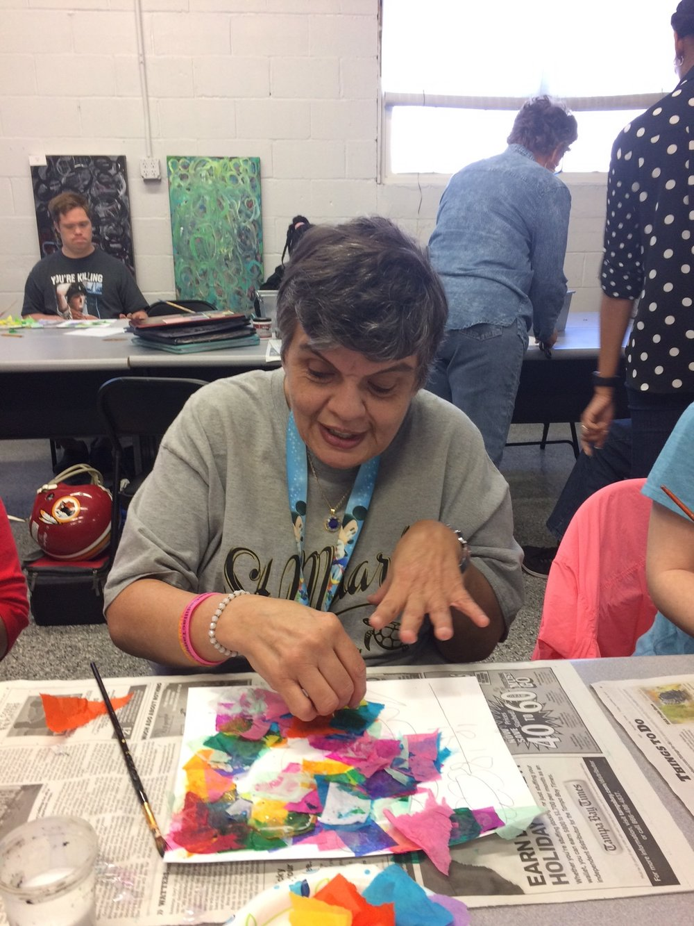 Featured artist Linda M. working on one of her mixed media pieces.
