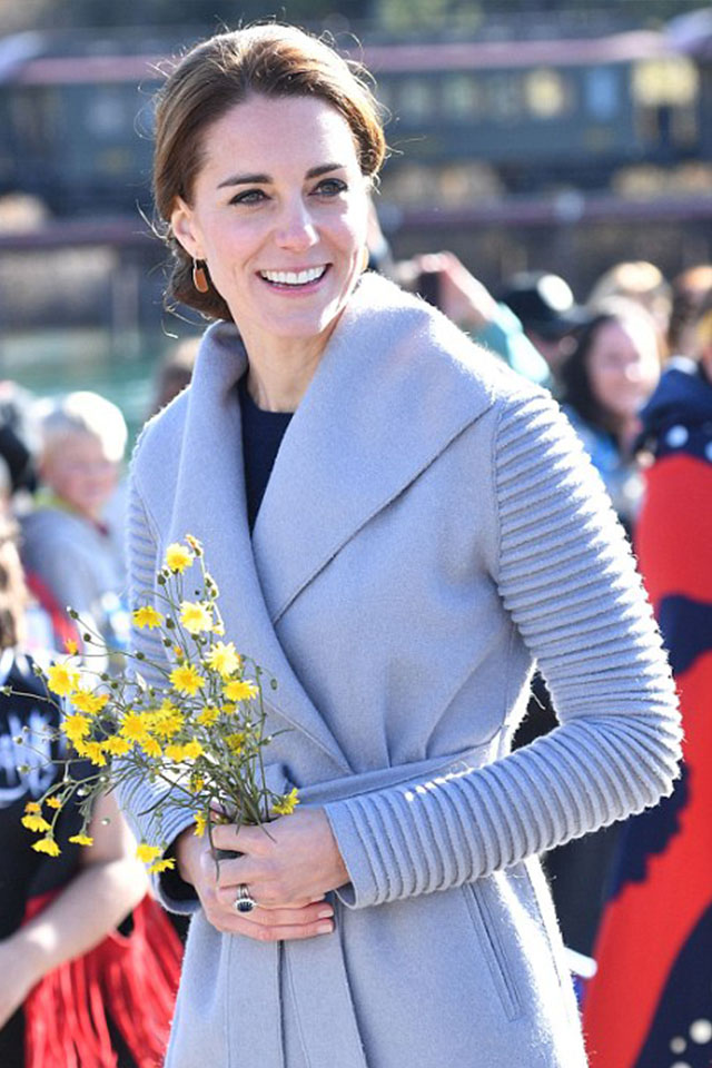 KATE MIDDLETON wearing in the SENTALER Wrap Coat with Ribbed Sleeves in Gull Grey on during the Royal Tour of Canada | photo by:  Getty Images