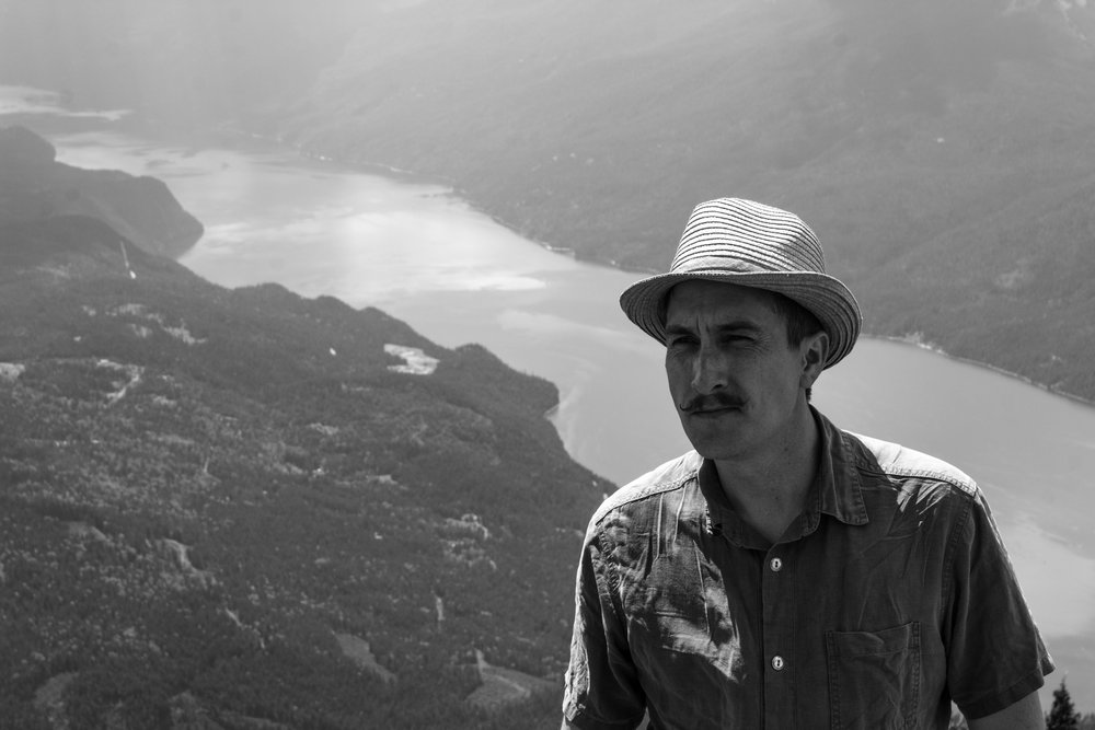 My cousin Travis at the top of Idaho Peak - Silverton, BC  Copyright © Afro Boy Productions. All rights reserved.
