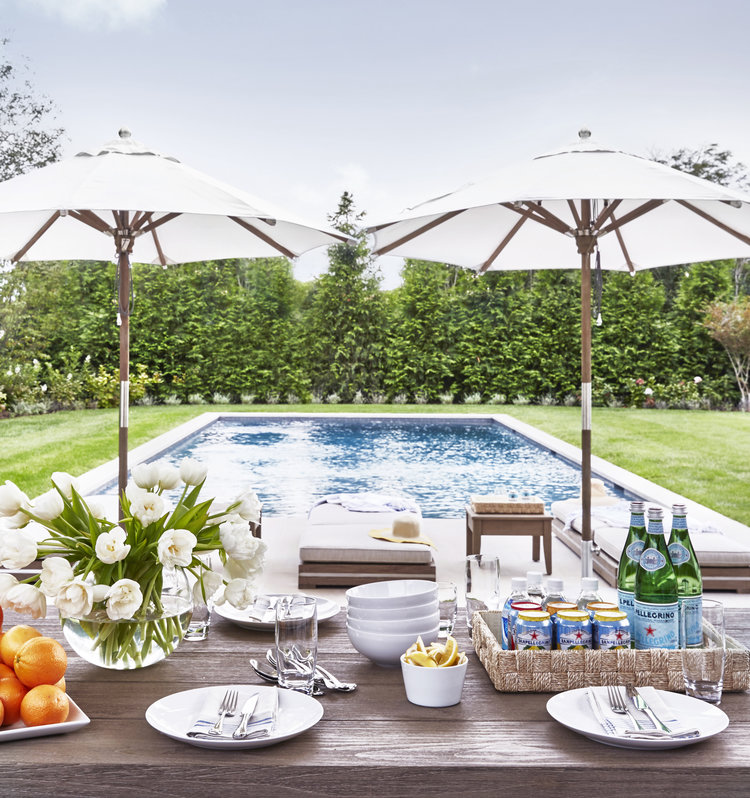 Looks so inviting, and   white outdoor umbrellas  are so chic