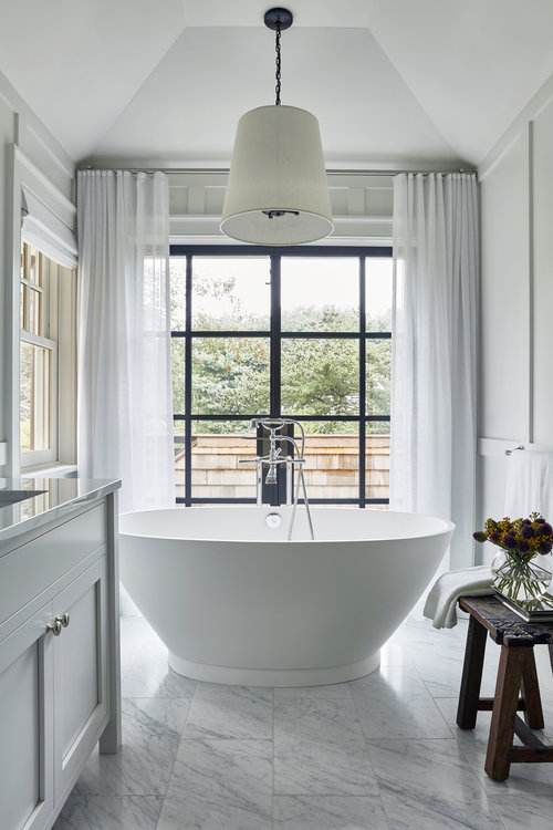 Elegant but casual spa-like bathrooms with white marble floors and shower...a luxurious way to end the day.