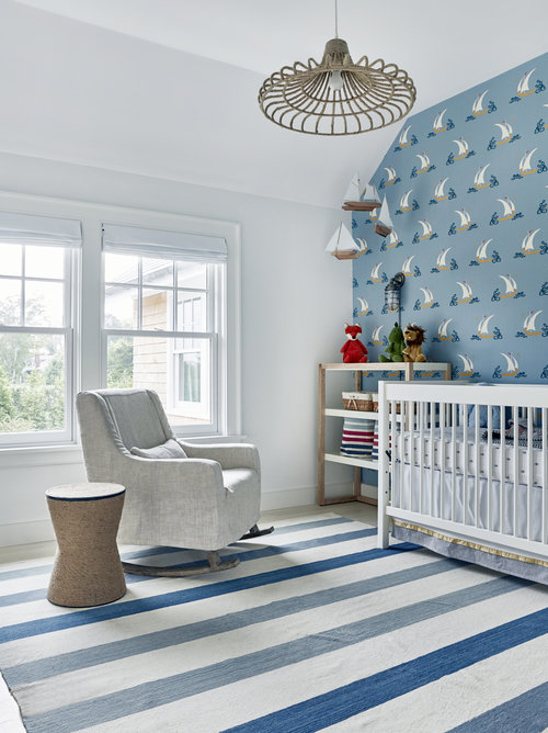 The wall decor is so whimsical for a little boy's nursery, the anchor decals are from  Urbanwalls.