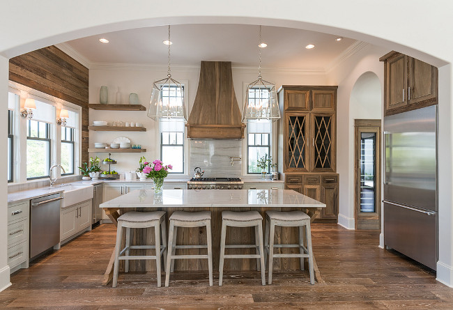 The designer's used cypress wood through out the house, including the floors, floating shelves, and custom built island and cabinets. The counter tops are made from  Bianco Macaubus Quartzite.