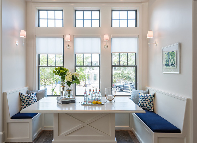 It makes sense in a beach house to have a breakfast nook, it is casual and can seat a bunch. The scones are Sconces are Thomas O'Brien Bryant Sconces from Circa Lighting