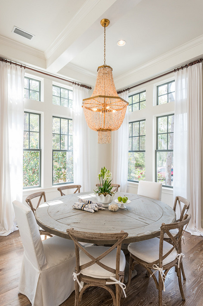 The Cypress Wood reminds me of driftwood. A boho vibe with the beaded chandelier and french cafe chairs, and the floors are red oak, and the designer had them wire-brushed and stained in a multi-step process. Similar  Dining Room Table  with Teak Wood. Similar  Beaded Chandelier