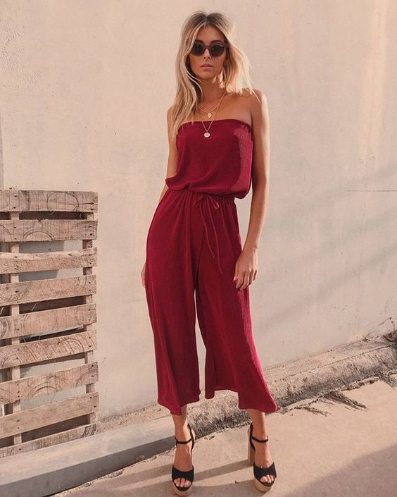 - A jumper with a strapless neckline with drawstring waist, and flare cropped legs.
