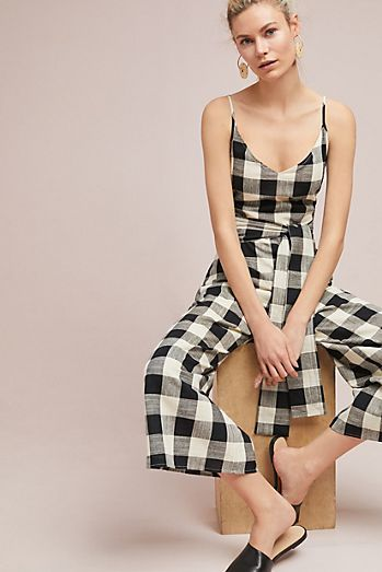 - A gingham jumpsuit bohemian vibe that's perfect for sun-soaked adventures.