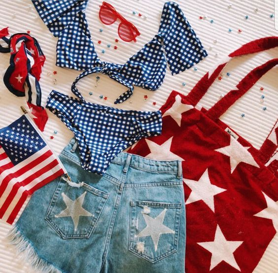 1.  blue and white bikini  2.  denim shorts with star stamped pockets  3.  red and white tote