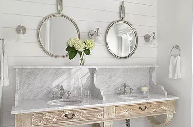Vintage bathroom vanity is a refreshing look…with round port-hole inspired mirrors..