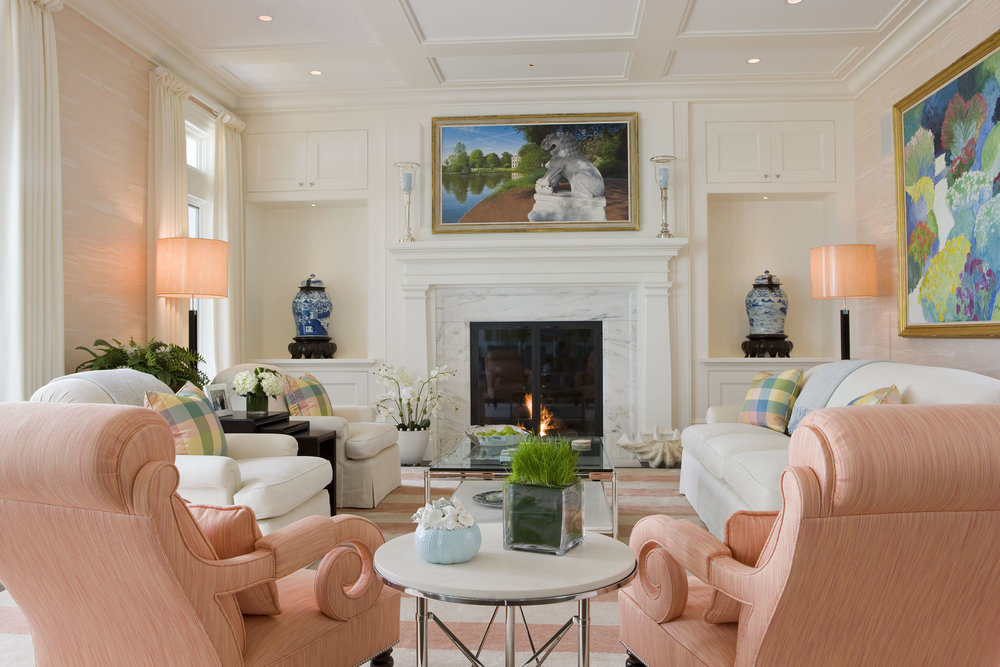 I love the soft orange sherbet chairs in this living room, so glamorous with an updated twist!