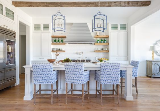 How pretty are these upholstered blue kitchen chairs and blue trimmed kitchen pendant lighting?
