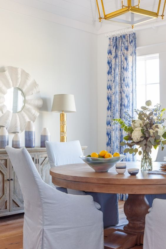 This dining room is beyond beautiful, every dreamy color of a day spent at the beach is here,