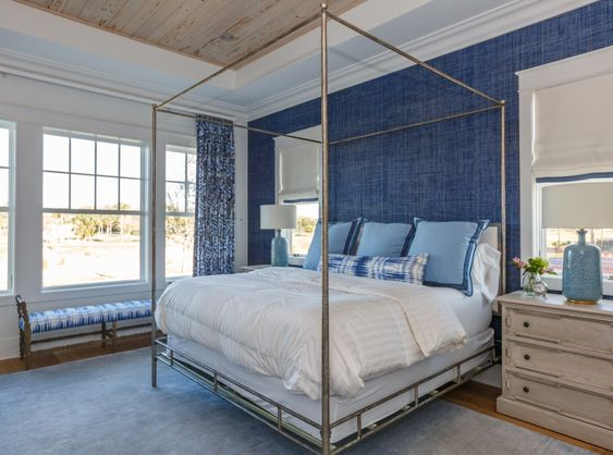 This Steel Framed Open Canopy Bed is Classically Elegant…and behind the bed, the wall is dressed in a deep blue grasscloth wallpaper…another mesmerizing detail.