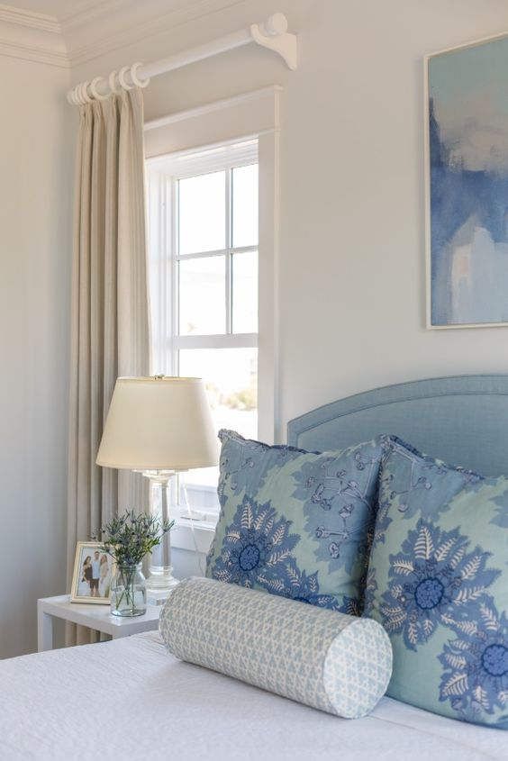 Soft and Pretty…Light Blue Upholstered Headboard and Designer Pillows…lovely.